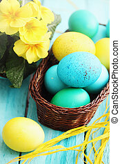 Still basket and eggs - Easter still life basket of colored...
