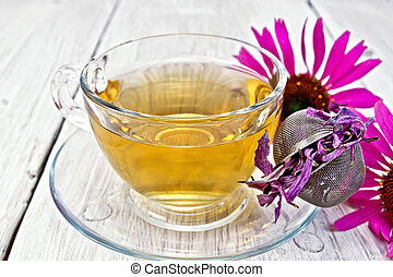 Tea Echinacea in glass cup with strainer on board - Herbal...