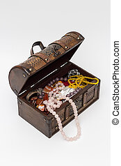Wooden vintage trunk with beads.