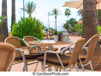 Mediterranean cafe terrace exterior with chairs
