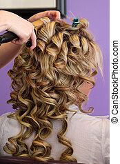 Bridal Hair Styling - A young attractive bride getting her...
