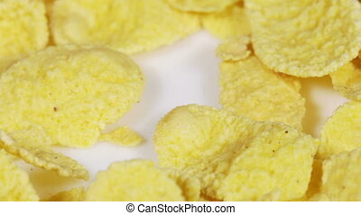 Corn flakes - Rotating on white plate Corn flakes
