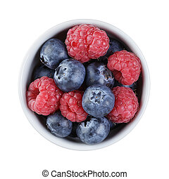 fresh raspberry and blueberry in bowl directly above,...