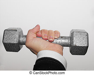 weight in hand - female hand holding a five pound weight