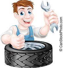 Tyre and Spanner Mechanic - Mechanic holding spanner and...
