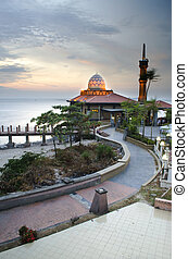 Malaysian Mosque with sunset - Malaysian mosque located in...