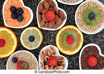 Health Food - Health food selection in porcelain bowls over...
