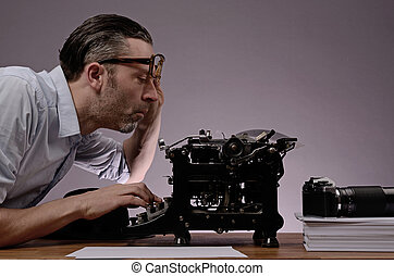 Editor working - Editor with an old typewriter and retro...
