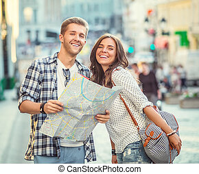 Happiness - Smiling couple with a map in the city