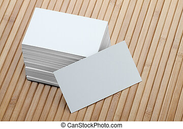 Bunch of Blank White Business Card on Wooden Background