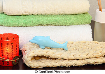 Towel stack, bast and soap.