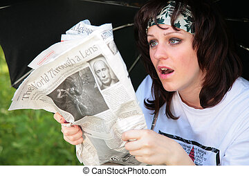 woman under umbrella with newspaper with Putin is surprised