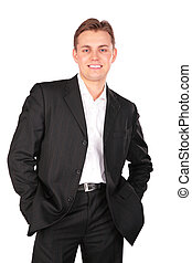 Young man in suit posing hands in pockets
