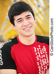 smiling young man on footbridge