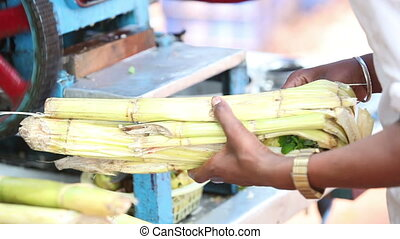 indian guy makes reed juice with machine - indian guy makes...