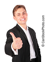 Young man in suit gives gesture