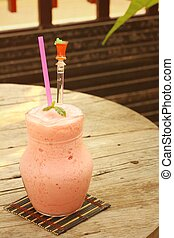 Fruit smoothies in glass placed in the garden
