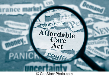 ACA text - News headlines and magnifying glass with...