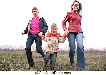 family run outdoor in city on spring