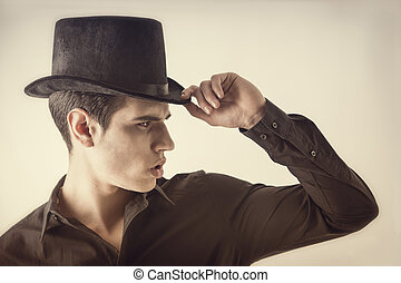 Portrait of a Young Vampire Man with Black Shirt and Top...