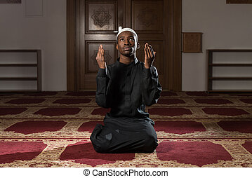 Humble African Muslim Prayer - African Muslim Man Making...