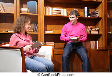 young couple with books