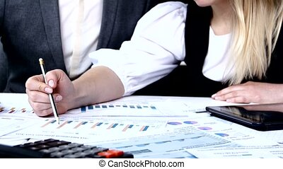 Successful people discussing business charts Each proves his...
