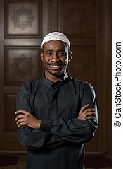 Portrait Of A Black African Man In Mosque - African Muslim...