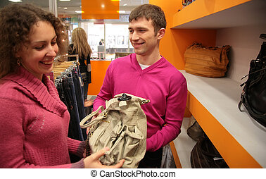couple sees bag in shop