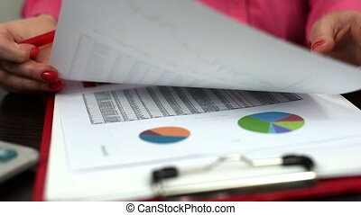 financial report - woman considering financial report