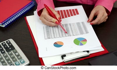 businesswoman working - businesswoman considering financial...
