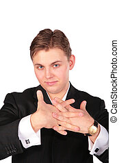 Young man in suit training fingers