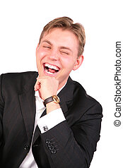 Young man in suit laugh