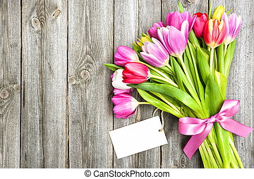 bouquet of spring tulips with empty tag
