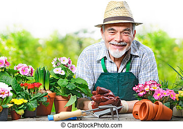 Senior man in the flower garden - Portrait of senior man in...