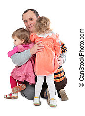 Man embrace three kids