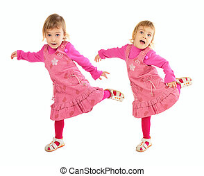 Little girl in pink dress dancing