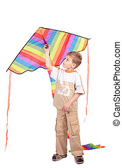 boy holds kite