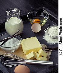 Baking ingredients eggs, flour, sugar, butter, vanilla,...