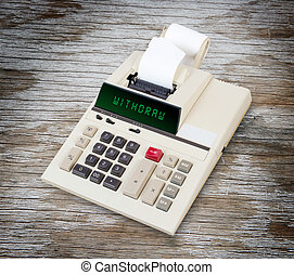 Old calculator - withdraw - Old calculator showing a text on...