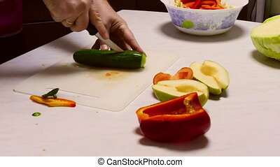 Cooking salad - Man sliced cucumber for vegetable salad