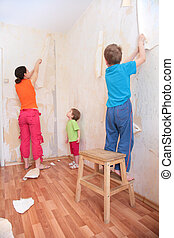 mother with children break wallpapers from  wall