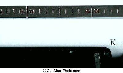 Typewriter. Typing text: kiss me