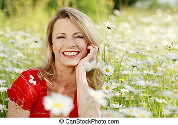Happy woman in flower field outdoor - Happy woman in flower...