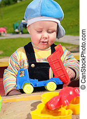 child and toy car outdoor