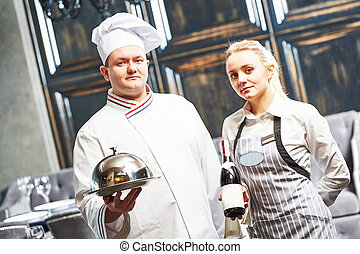 waitres and chef in restaurant - Waitress with tray cloche...