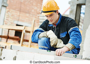 construction mason worker bricklayer working level levelling...