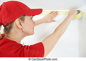 Home Painter with masking tape - Woman painter worker...