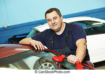Windscreen repair - Automobile glazier repairman at...
