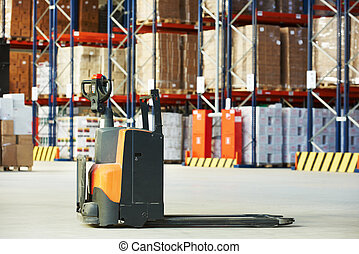 pallet stacker truck at warehouse - Manual forklift pallet...